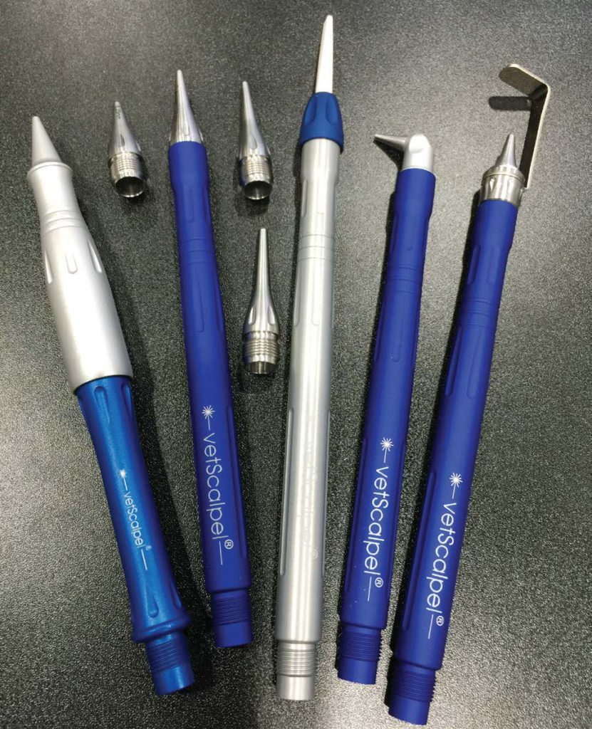 FIGURE 3: VetScalpel autoclavable miniaturized tipless handpieces with tipless laser nozzles and wide ablation nozzle (shown in the middle).